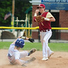 JIM VAIKNORAS/Staff photo Newburyport's Tom Furlong turns a double play as Georgetown's Scott Petrie slides into second during the annual Bert Spofford tournament at Georgetown Sunday.