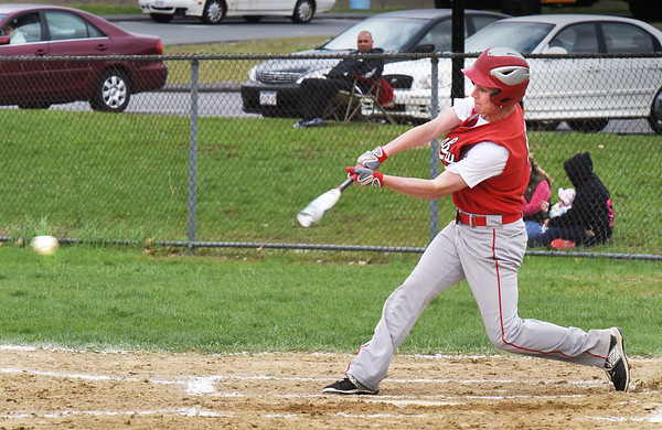 BRYAN EATON/Staff photo. Amesbury's Ray Arsenault pops a single.