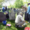BRYAN EATON/Staff photo. Cemetery preservationist Rachel Meyer led a workshop for members of First Parish Church of Newbury on how to clean and protect old headstones this past weekend. Participants learned techniques that will allow for ongoing headstone cleaning as part of a larger cemetery restoration effort. The workshop wass funded by a grant from the Newbury Cultural Council.