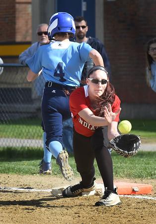 BRYAN EATON/Staff photo. Triton's Mitchell makes it to first base as Amesbury's Mikayla Porcaro catches the late throw.
