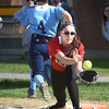 BRYAN EATON/Staff photo. Triton's Mitchell makes it to first base as Amesbury's Mikayla Porcaro catches the late throw.