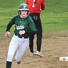 BRYAN EATON/Staff photo. Pentucket's Megan McCoy rounds second on her home run hit.