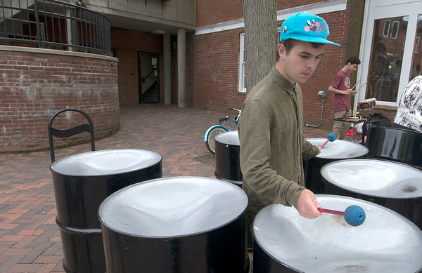 JIM VAIKNORAS/Staff photo Aidan Kelly of Newburyport plays the Steel Drums withe the Zach Field Drum Studio at the <br /> Newburyport Spring Festival on Inn Street Sunday