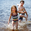 BRYAN EATON/Staff photo. Brooke Tremblay, 3, and her brother Miles, 6, splash around at Lake Gardner Beach in Amesbury. They were there cooling off with the mom Laura as the temperature hovered in the high 80's.