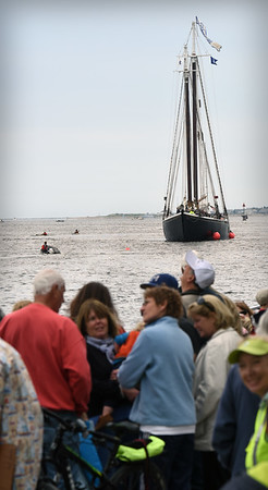 BRYAN EATON/Staff photo. Throngs of spectators were on the Newburyport Boardwalk as the Adventure sailed into port to join the other tall ship Alabama.