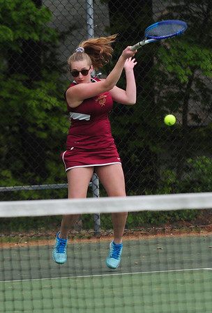 JIM VAIKNORAS/staff photo Newburyport third singles player Andria Samualson returns a shot from Masconomet's Caroline May during their match at Atkinson Common Thursday.
