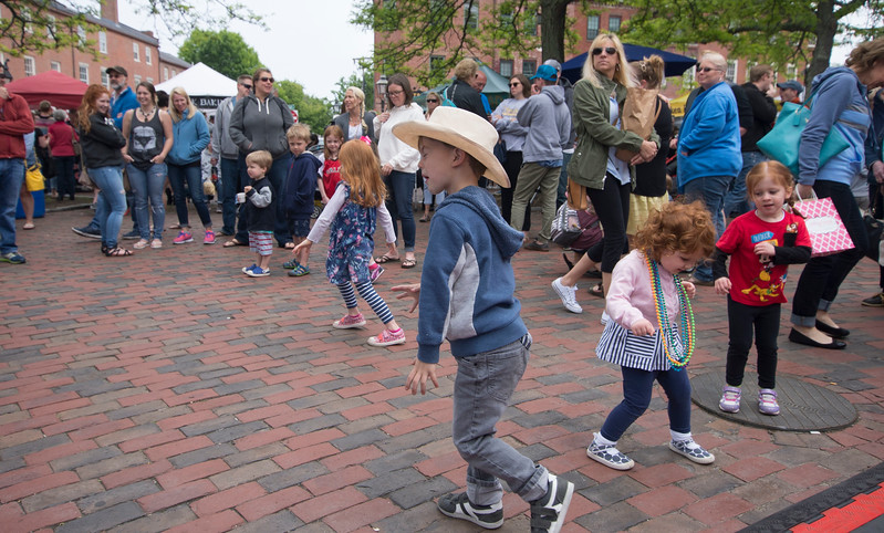 JIM VAIKNORAS/Staff photo Dancing and music fill MArket Square at the Newburyport Spring Festival on Inn Street Sunday.