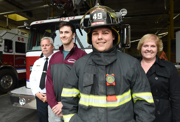 BRYAN EATON/Staff photo. From left, Newburyport fire chief Christopher LeClaire, Matt Raven, firefighter Nick Ault and Michelle Ault.