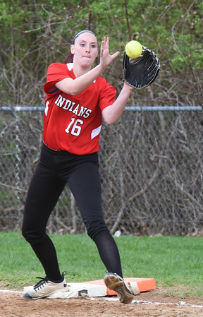BRYAN EATON/Staff photo. Amesbury first baseman Mikayla Porcaro has the throw forcing out a Lynnfield player.