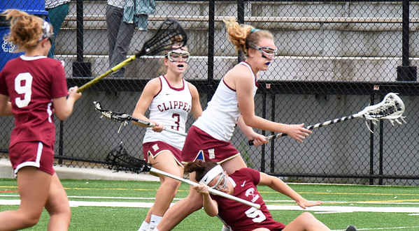 BRYAN EATON/Staff photo. Gloucester's Julia Wood goes down as Newburyport's Kathleen Geary gets the ball.