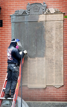 BRYAN EATON/Staff photo. Jeff Buccacio, of Buccacio Sculpture Studios of Canton, sub-contracting for Skylight Studios, sandblasts one of two World War One memorial plaques on Newburyport City Hall to bring them back to  their original condition. The work is paid for by the Memorial Brick Program where people purchase a brick inscribed with a friend or relative who served in the armed forces and the installed in the veteran's park acros the street.