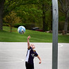 BRYAN EATON/Staff photo. Short on inches, but high on aspirations, Brogan Beckman, 4, of Amesbury tries to put the basketball in the hoop at Amesbury Town Park on Tuesday morning. He was there with his mother Kim along with other pre-schoolers in the playground area.