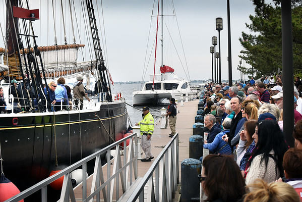 BRYAN EATON/Staff photo. People watch as the Adventure ties up to the Newburyport waterfront.