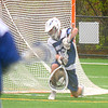JIM VAIKNORAS/staff photo Georgetown goalie .... makes a save during the Royal's  game against Newburyport at World War Memorial Stadium in Newburyport Friday.