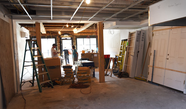 BRYAN EATON/Staff photo. The buildout of Abraham's Bagels is nearing completion and soon equipment will be installed.