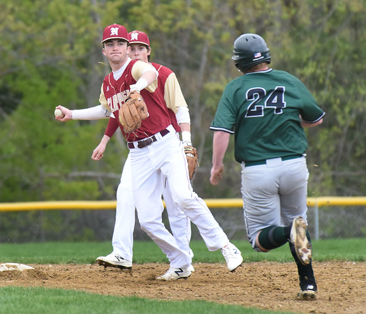 BRYAN EATON/Staff photo. Newburyport shortstop John Cahalane forces out Pentucket's Nathan McCarthy then throws to first on a double play.
