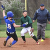 BRYAN EATON/Staff photo. Georgetown's Irons steals second as the ball was overthrown past Pentucket shortstop Kim Kowalick.