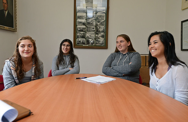 RYAN HUTTON/ Staff photo<br /> From left, Newburyport High seniors Julia DiBiase, 18, Quinn Campbell, 17, Kaitlin Clarke, 18, and Charlotte Graf, 18, talk about the preparations for the upcoming prom.