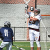 BRYAN EATON/Staff photo. Newburyport goalie Chris Utt jumps for the save.