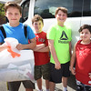 BRYAN EATON/Staff photo. Amesbury Middle School students have been doing community service projects including picking up trash at Salisbury Beach. From left, Daniel Hutchings, 10, Aiden Allen, Andrew Lucier and Sean Rodriguez, all 11.