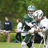 BRYAN EATON/Staff photo. Pentucket's Chris Muollo grabs a loose ball as Manchester-Essex player Logan Carroll moves in.