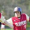JIM VAIKNORAS/staff photo Newburyport's Jaden Medeiros is congratulated by teammate Christopher Halliday after his 2 run single during their game at Amesbury High School Thursday.