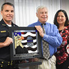 BRYAN EATON/Staff photo. Stained glass artist Ali Beauchamp, right, created this artwork to the men and women who serve the public as police officer and military personnel. Accepting the work, to be displayed in the Newburyport Police Department for now, Marshall Mark Murray, left, and veteran's agent Kevin Hunt.