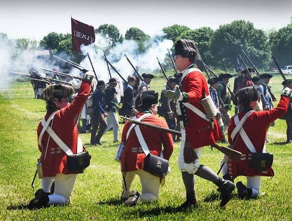 BRYAN EATON/Staff photo. The revolutionaries engage the British Army in the battle reenactment at Spencer-Peirce-Little Farm in Newbury.