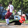 BRYAN EATON/Staff photo. Amesbury's Madison Napoli slides into home plate on an error, earlier in the inning batting in two of her teammates.