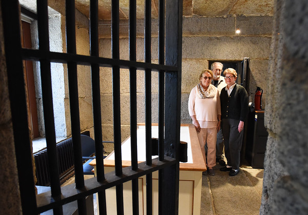 BRYAN EATON/Staff photo. Jillian and Charles Griffin, left, with Stephanie Niketic of the Newburyport Preservation Trust will be opening the old jail, or gaol, which then own as part of a tour for a fundraiser for the group.