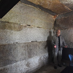 BRYAN EATON/Staff photo. Charles Griffin shows off a cell for women and stands under a plugged hole where there was a chimney for a Franklin stove.