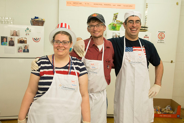"""JIM VAIKNORAS/staff photo Coastal Connections event committee members Stephanie Caron, Mike Green and Ray J. DiFiore take a break from cooking and decorating to pose for a photo """" A Brunch for Vets """"  Friday morning to thank local veterans in Amesbury."""