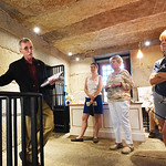 BRYAN EATON/Staff photo. Newburyport Preservation Trust board member Reg Bacon speaks to visitors at the old Newburyport Jail (Gaol) on Friday night. The open house at the privately-owned bu ...