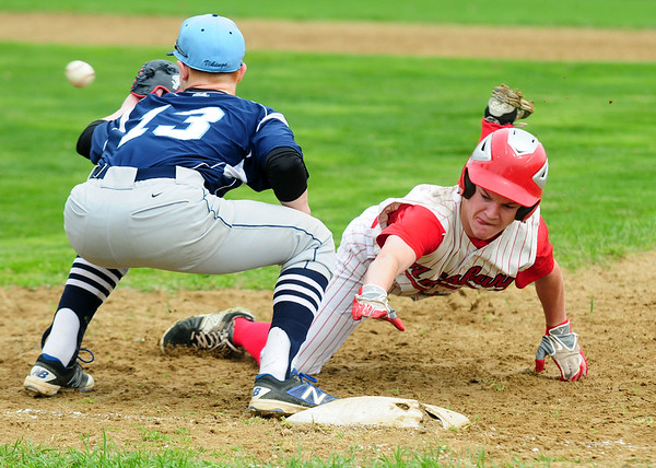 JIM VAIKNORAS/staff photo Amesbury's Ray Arsenault dives safely back to first as Triton's Tyler Godfrey waits for the throe during their game at Amesbury Saturday morning.