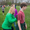 JIM VAIKNORAS/staff photo Stephanie Faloon marks the laps on a the back of her son Andrew during the Pine Grove School in Rowley annual Jog-A-Thon. Kids collected pledges per 5th of a mile laps around the back fields at the school to raise money for the school.