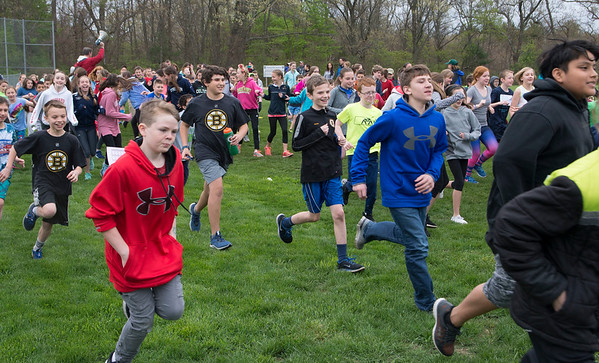 JIM VAIKNORAS/staff photo Students take off at the Pine Grove School in Rowley annual Jog-A-Thon. Kids collected pledges per 5th of a mile laps around the back fields at the school to raise money for the school.