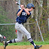 JIM VAIKNORAS/staff photo Triton's Ross Lojek hits a 2 run single during the Vikings game at Amesbury Saturday morning.