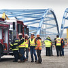 BRYAN EATON/Staff photo. Workers on the Whittier Bridge Project check out the Amesbury Fire Department's new fire engine.