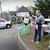 BRYAN EATON/Staff photo. Residents of Merrimac headed to the town's library to vote on Monday. Waving to voters as they entered the parking lot, from left, Earl Baumgardner, Rich LeSavoy and Joel and Courtney Breen.