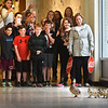 BRYAN EATON/Staff photo. Nock Middle and Molin Upper Elementary students with staff watch as a mother duck and her 13 chicks leave the courtyard at the school and head down the hallway. Once outside, the staff guided them along and stopped traffic on Low Street in Newburyport where they headed to the pond the mother calls home.