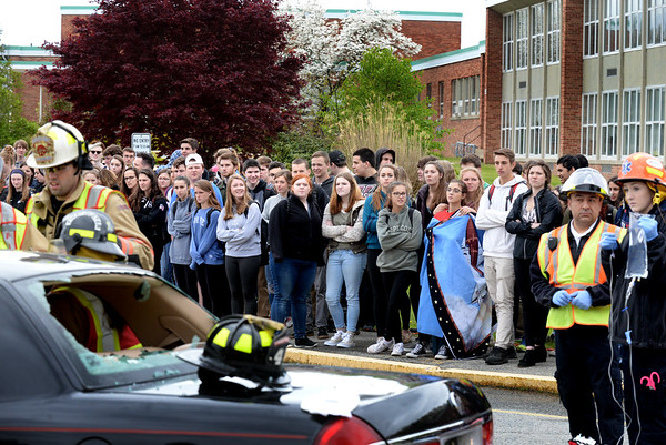 BRYAN EATON/Staff photo. Students was as police, firemen and EMT's respond to a drunk driving mock crash at Pentucket High School on Monday afternoon.