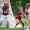BRYAN EATON/Staff photo. Gloucester's Rachel Alexander defends her goalie, Lily Kuhns, as Newburyport's Molly Rose Kearney looks for an opening.