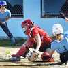 BRYAN EATON/Staff photo. Triton's Penniman makes it home as Amesbury catcher Caitlyn Baker goes for an errant throw.