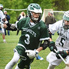 BRYAN EATON/Staff photo. Hornets' #3 looks for an open teammate past Pentucket's Ethan Dore.