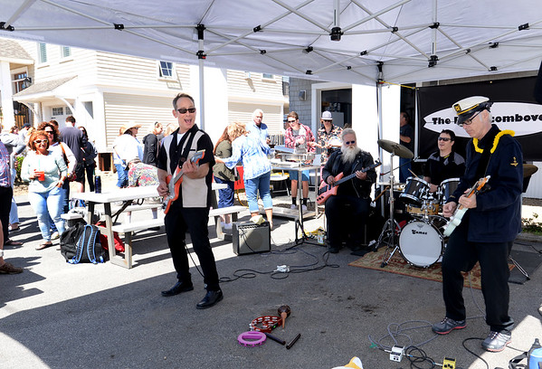 BRYAN EATON/Staff photo. The Beachcombovers played their surf music in Bob Connors' Annapolis Way driveway during PlumFest on Saturday. The daylong music event brough hundreds to the sland via car, shuttle or bicycle to hear a variety of music on people's porches, patios or driveways.