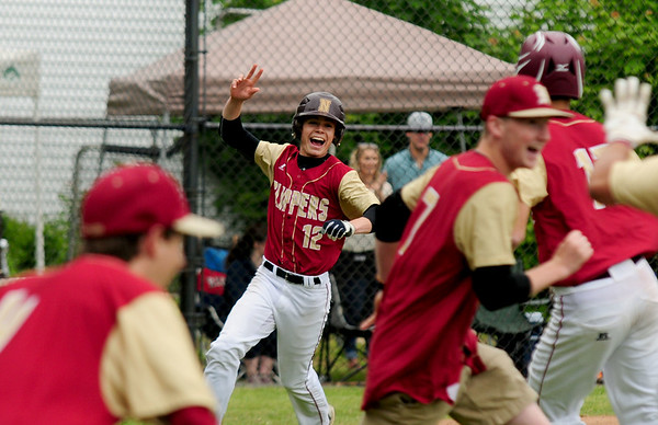 JIM VAIKNORAS/Staff photo Newburyport's Michael Twoney scores the game winning run against Georgetown winning the annual Bert Spofford tournament at Georgetown Sunday.