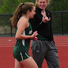 JIM VAIKNORAS/staff photo Pentucket's Katie Giusti and Siobhan Mictell talk at the Hernry Sheldon track meet at Triton Saturday. The teammates tied in the high jump.
