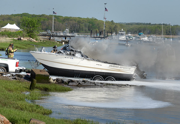 BRYAN EATON/Staff photo. Newburyport firefighters responded to a boat fire on a trailer at the northern ramp at Cashman Park on Friday morning. There were no injuries.