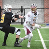 BRYAN EATON/Staff photo. Bishop Fenwick's Jacob Hebert puts pressure on Newburyport's Robert Shay.