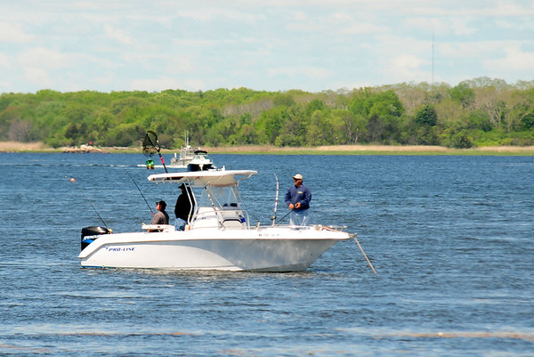 JIM VAIKNORAS/Staff photo Fsihermen off Plum Island Point in Newburyport hope to hook stripped bass as the tide comes in teh mouth of the Merrimack River Saturday.